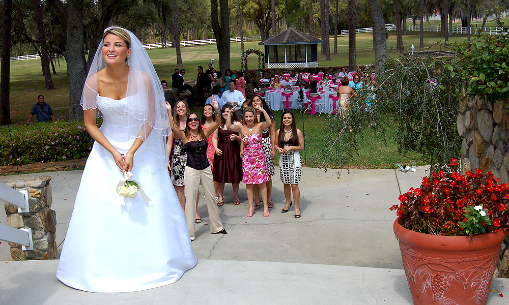 Wedding Guests Eager To Catch The Bouquet