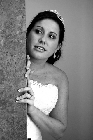 A Curious Bride Caught Peaking Around The Corner