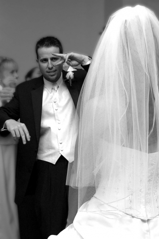 A Happy Groom Voguing With His Lovely Bride