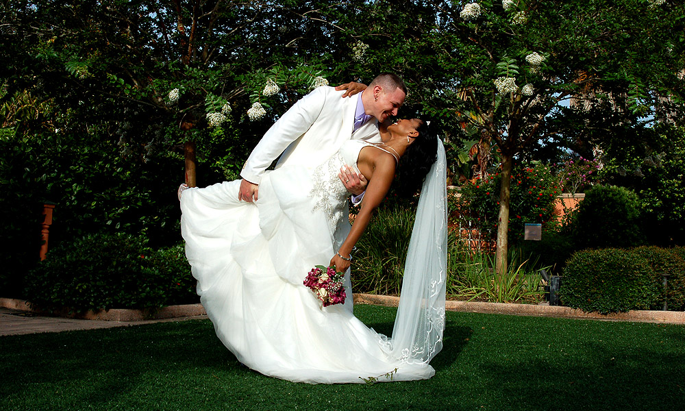 A Happy Groom Dipping His Lovely Bride At The Florida Botanical Gardens